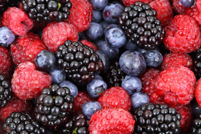A mix of strawberries, blueberries, and blackberries